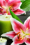 Spa still life with candle and pink lilies Royalty Free Stock Image