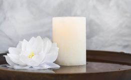 Spa still life with candle and water lily, spa still life composition natural wellness still life with candle and lotus in water royalty free stock image