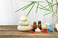 Spa still life with candle,zen stone and essential oil. On wooden table Royalty Free Stock Photos