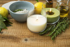Spa still life with candles, salt, rosemary herb, olive oil  on Stock Images