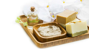 Spa still life with clay mask,natural soap and orchid Stock Photos