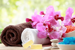 Spa still life with essential oil, salt, orchid and towel Royalty Free Stock Photography