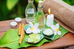 Spa still life with frangipani, towel, candles, fresh aloe Royalty Free Stock Image