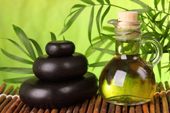 Spa still life with hot stones. And essential oil Stock Photography