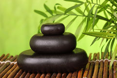 Spa still life with hot stones Stock Photography
