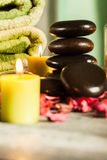 Spa still life with hot stones and candles Stock Photography