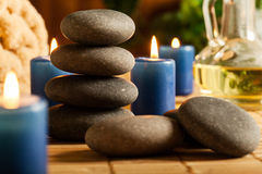 Spa still life with hot stones and candles Stock Image