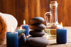 Spa still life with hot stones and candles Stock Photos