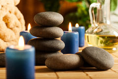 Spa still life with hot stones and candles Royalty Free Stock Image