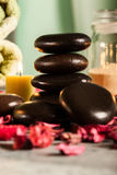 Spa still life with hot stones and candles Stock Images