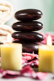 Spa still life with hot stones and candles Royalty Free Stock Images