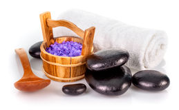 Spa still life with lavender salt. Black stone and white towel on background Royalty Free Stock Images