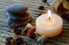Spa still life - massage stones,candle,body scrub components Stock Photography