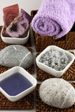 Spa still life with natural soap, salt crystals. Spa setting with bath towel, natural soap, salt crystals and candles Stock Photos