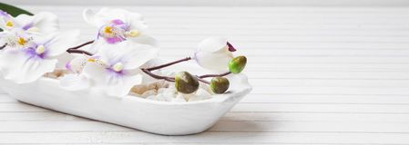 Spa still life with orchid and bath salt, spa setting Royalty Free Stock Images