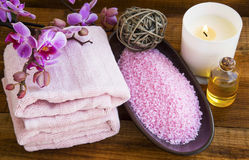 Spa still life with orchid flowers, towels,salt, scent candle an Stock Images
