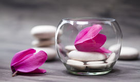 Spa still life with pink orchid, white zen stone and tea candle Stock Images