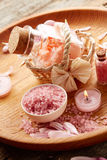 Spa still life with pink sea salt and flower petals Royalty Free Stock Images