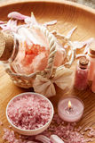 Spa still life with pink sea salt and flower petals Stock Images