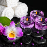 Spa still life of purple orchid dendrobium, leaf with dew, towel Stock Photo