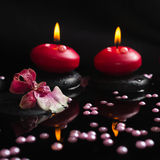 Spa still life of red candles, zen stones with drops, orchid Royalty Free Stock Photos