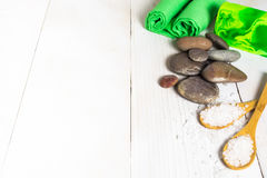 Spa still life with salt, stone, green material and soap Royalty Free Stock Photos