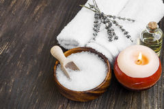 Spa still life with sea salt, towels and bath oil Stock Photo