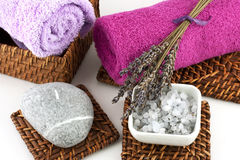 Spa still life. Spa setting with bath towel, natural soap, salt crystals and candles Stock Photos