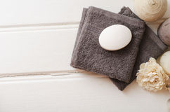 Spa still life - a soap and towels on a wooden background Royalty Free Stock Photos