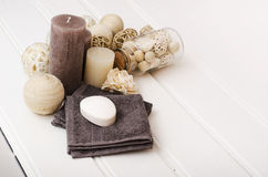 Spa still life - a soap and towels on a wooden background.  Royalty Free Stock Photography
