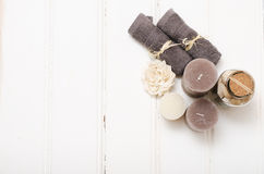 Spa still life - a soap and towels on a wooden background.  Stock Image