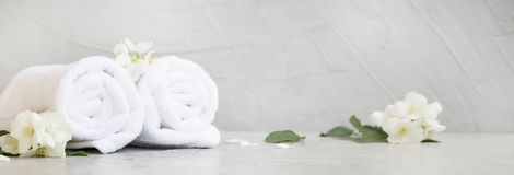 Spa still life. With towels and jasmine flowers Stock Photography