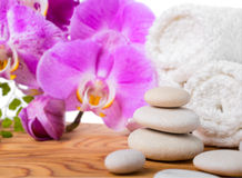 Spa still life with stone, lilac orchid Royalty Free Stock Images