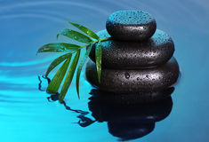 Spa still life with stone pyramid. Reflecting in water Stock Photography
