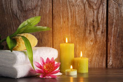 Spa. Still life with towel,burning candles and lotus Stock Images
