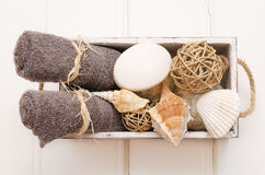 Spa still life - towel and soap in an old box.  Royalty Free Stock Image