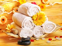 Spa still life  with towel in wood spa. Royalty Free Stock Images