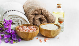 Spa still life with towels,purple towels, salt and bath oil Stock Images