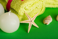 Spa still life. Towels, starfish, candle,  in a massage studio Stock Photos