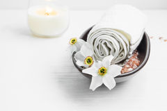 Spa still life with white flowers, bath salt and towel Stock Photography