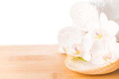 Spa still life with white orchid, shell and towel Royalty Free Stock Photography