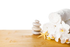 Spa still life with white orchid, starfish and towel Stock Photos