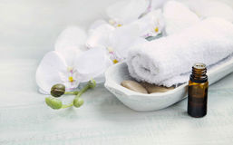 Spa still life. With white orchid and towel, bath essence oil bottle Stock Photography