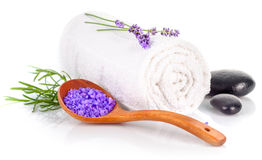 Spa still life with white towel and lavender salt. On background Royalty Free Stock Photography