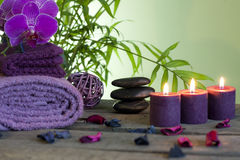 Spa still life with zen stones and aromatic candles Royalty Free Stock Image
