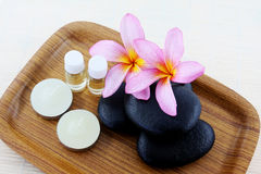 Spa stone. And frangipani flower in the tray Stock Image