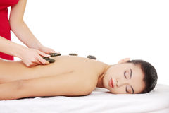 Spa stone massage. Beauty woman relaxing in spa. Stone massage stock photos