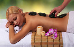 Spa Stone Massage. Beautiful Blonde Royalty Free Stock Photography