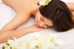 Spa Stone Massage. Beautiful Woman Getting Spa Hot Stones Massag. E in Spa Salon. Beauty Treatments Outdoor. Nature Stock Images