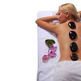 Spa Stone Massage. Blonde Woman Royalty Free Stock Image